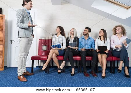 Business People Group Meeting Sitting In Line Queue, Businesspeople Recruitment Waiting for Job Interview Candidate Office Interior