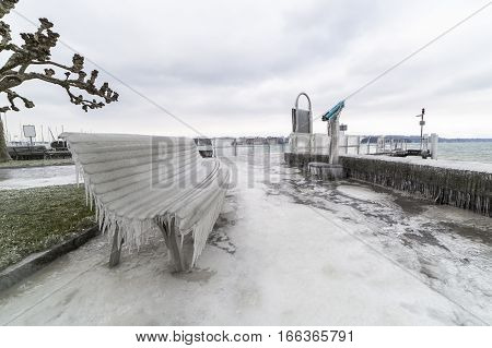 Lakeside promenade covered with ice after a winter storm on Lake Geneva.