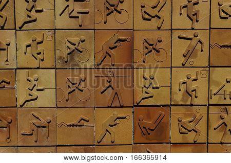 Sport icon set on earthenware brick wall. Sport pictogram