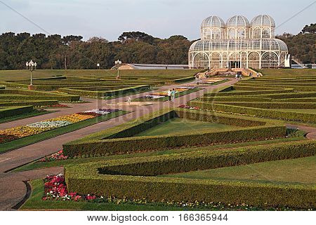 Photograph of the Botanic Garden in Curitiba with flowers and glass bottom background