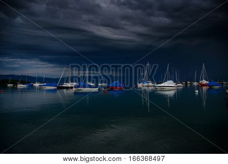Thunderstorm atmosphere at the harbour of Wasserburg Bodensee Germany poster