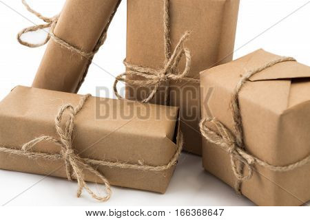 Stack of handcraft gift boxes on white background.