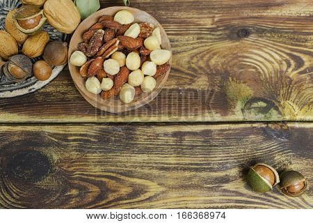 Roasted salted nuts mix snack from macadamia walnuts and almonds and unshelled nuts