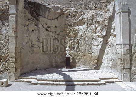 ruins of Santa Barbara hermitage with the figure of the virgin. taken on Santa Barbara castle in Alicante spain.