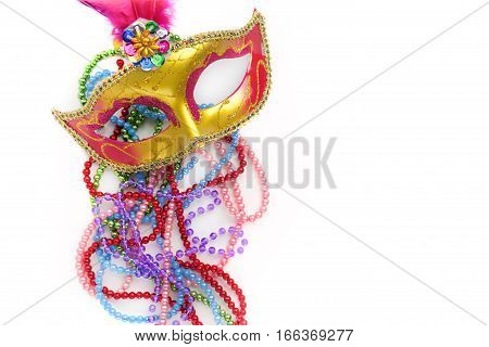 Mardi gras mask and beads on white background