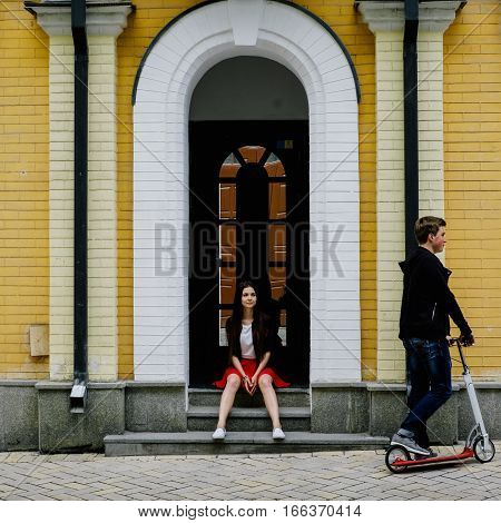 Man And Woman Travel On Scooters