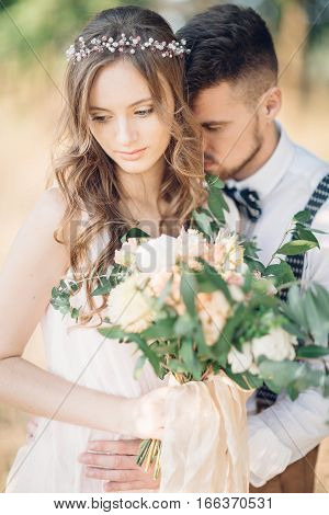 fine art wedding photography. bride and groom hugging at the wedding in nature.