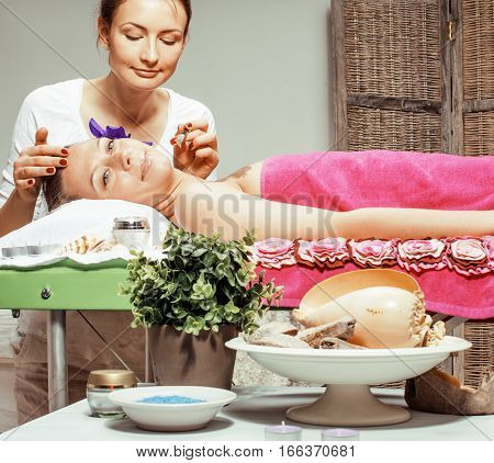 stock photo attractive lady getting spa treatment in salon, healthcare people concept close up