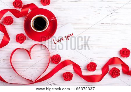 Valentines background with red heart coffee cup and roses. Valentines Day greeting card. Coffee break. Top view