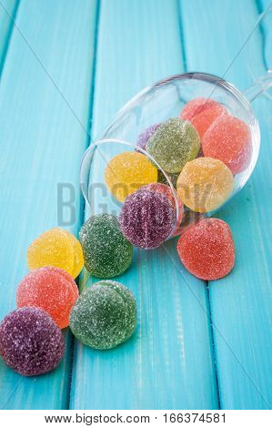 Sugar Coated Fruit Jelly And Glass On The Table
