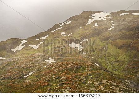 Landscape of Norway, mountains in fog, view from train