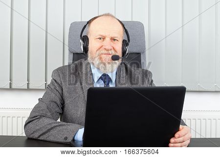 Picture of a cheerful manager having a video-conference at the office