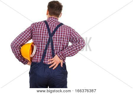 Picture of a young male engineer having a serious backpain