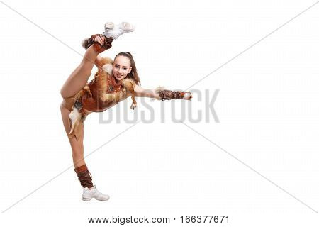 Young Professional Cheerleader Dressed In A Warrior Costume; Standing On One Leg . Vertical Splits