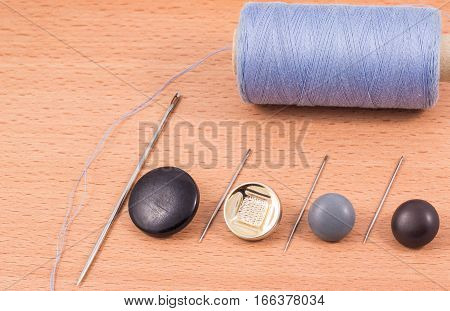 accessories for the textile industry with a needle and thread to sew buttons