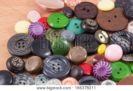 many different in appearance and color of the buttons are on the table such a background