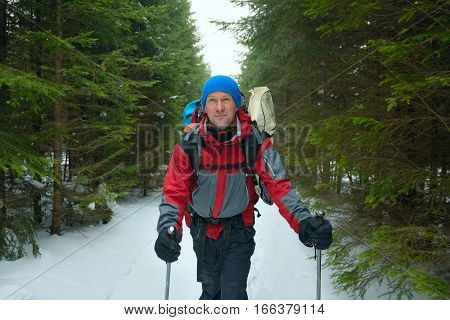 Happy Man With Backpack Goes On A Trail