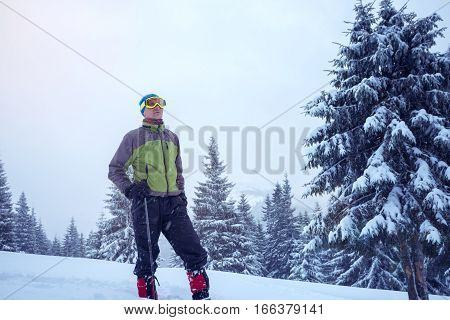 Determined Man In Goggles And Snowshoes