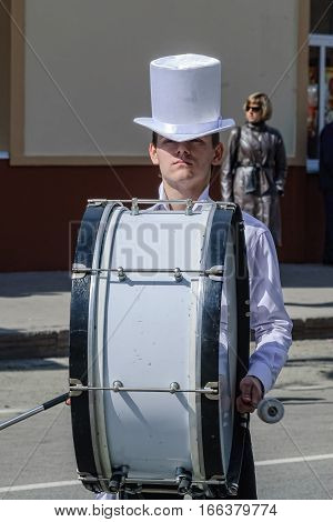 Tyumen, Russia - May 9. 2009: Parade of Victory Day in Tyumen. Drummer plays big drum in parade