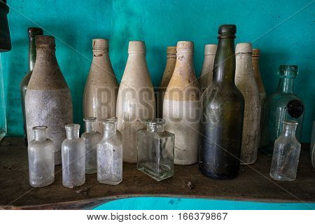 vintage bottles brought up from shipwrecks from the bottom of the sea in Panama