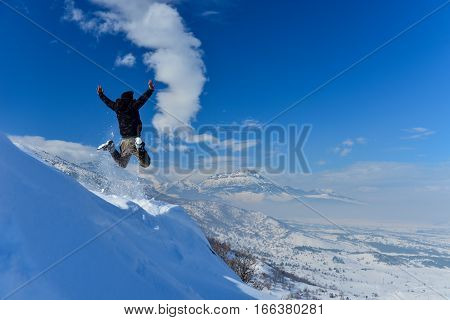 energetic movements in the snowy mountains & jumping