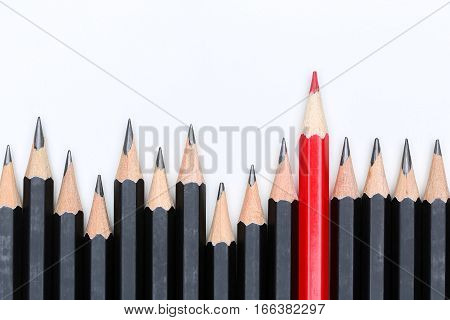 Red Pencil Standing Out From Crowd Of Plenty Identical Fellows