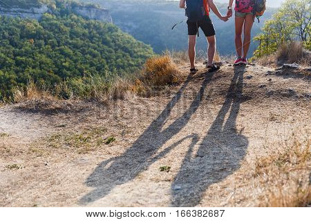 Shadow of young couple on hill in afternoon
