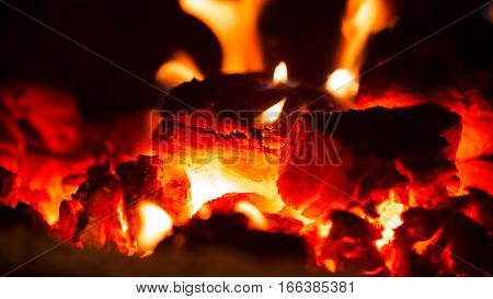 hot coals close-up in the darkness of night