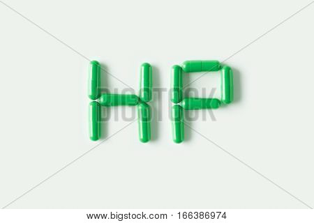 Green Pills Capsules In Shape Of Word Hp. Life Concept Isolated.