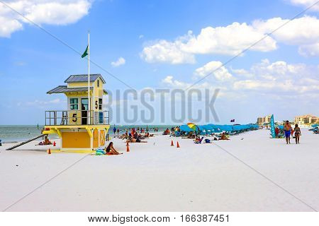 Clearwater, FL - April 21: Yellow Lifeguard tower and people on Clearwater beach in Florida