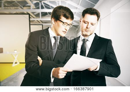 Two handsome businessmen in office with document. Teamwork concept. 3D Rendering