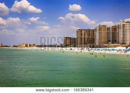 Clearwater, FL - April 21: People and Waterfront hotels on Clearwater beach in Florida