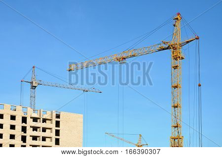Building Under Construction With Crane