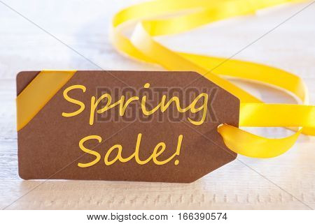 Label With English Text Spring Sale. White Wooden Background. Card For Seasons Greetings Or Easter Greetings