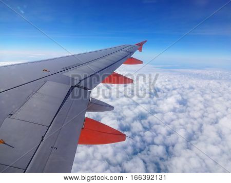 London, UK, March 15, 2014 : EasyJet jet aeroplane flying above the clouds in mid air on it's way to a holiday destination