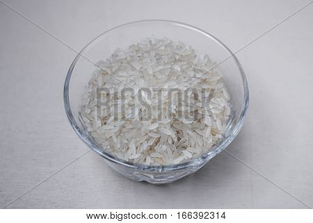 a bowl of rice on white surface. gluten free product.