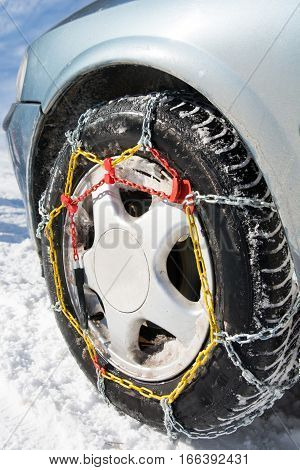 Snow Chains Mounted On Car Wheels