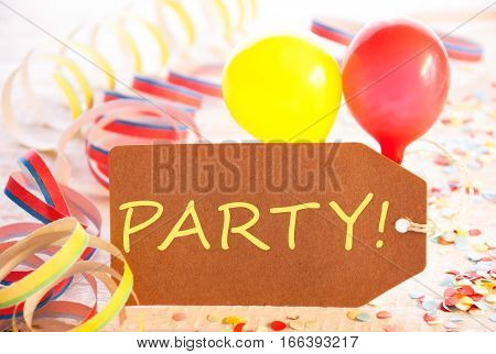 One Label With English Text Party. Party Decoration Like Streamer, Confetti And Balloons. Wooden Background With Vintage, Retro Or Rustic Syle