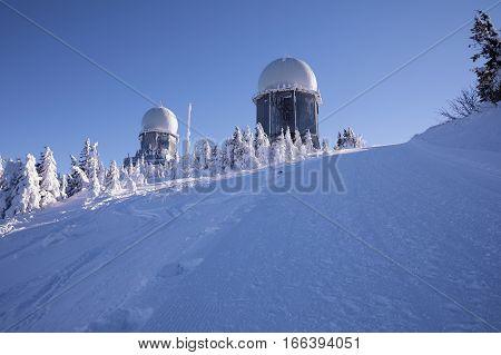 Winter observatory on Grosser Arber. Grosser Arber Bayerisch Eisenstein Germany. Winter snowy summit of Mt. Grosser Arber at Bavarian Forest (Germany).