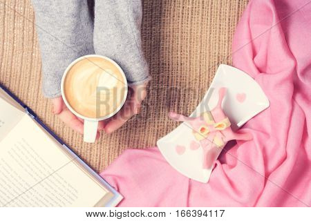 Girl Holding Cup Of Coffee With Latte Art. Valentines Day And Leasure Time Concept. Pastel Colors