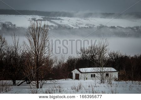 A little house in the fog in winter. Ile d'Orléans, Canada.