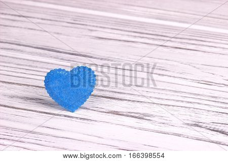 Light Blue heart of felt on a wooden background. Valentine Day.Greeting card.Wedding