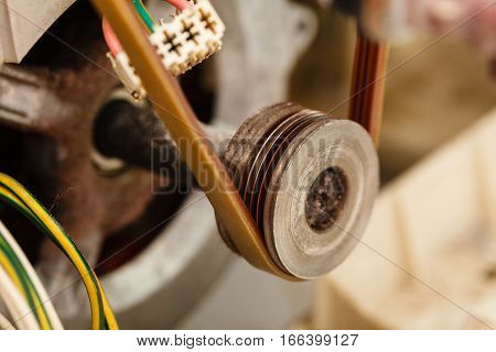 Repair mechanical industrial domestic concept. Insides of broken device. Internal parts of wasching machine exposed.