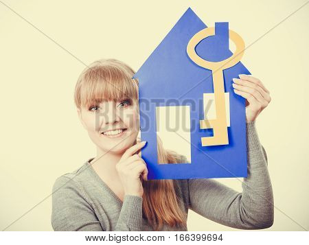 Young Lady Holding Housing Symbols.