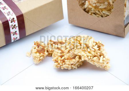 crispy rice snack food for healthy and diet in box on white background