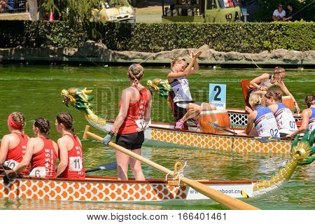 Rome Italy - July 30 2016: Dragon boat crews compete at the european championships held in Italy in 2016 summer Swisse crew and English girl clap her hands
