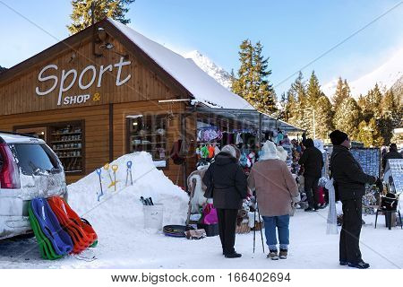 SLOVAKIA, STRBSKE PLESO - JANUARY 06, 2015: Local tourist market in Strbske Pleso. The village is a favorite ski tourist and health resort in the slovakian part of High Tatras mountains.