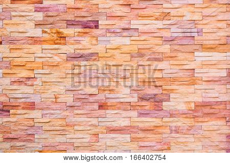 Backdrop of brown stone brick wall texture.
