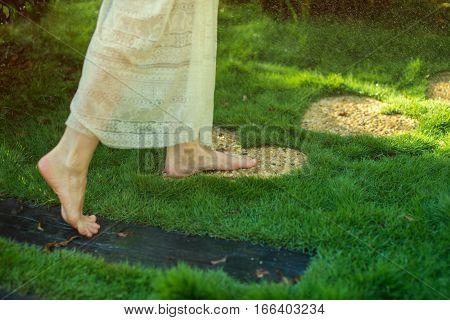 Girl Walking Barefoot On The Stones In Heart Shape