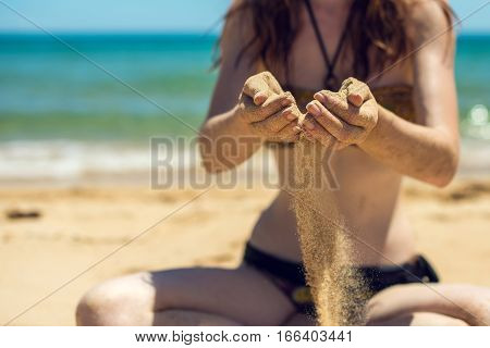 Girl Holding A Sand Sea Background